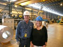 Alan Richardson inspects Painted Galvalume Steel Coils with Lana Keeton