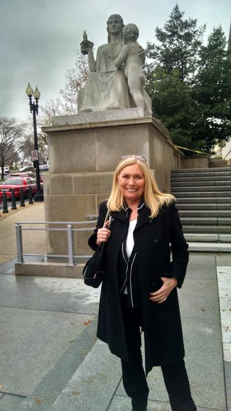 Lana Keeton in front of statue, Spirit of Justice,  at Rayburn House Office Building,  Washington,  D.C. Dec 3, 2014